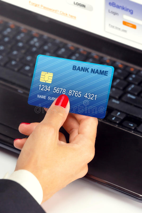 Female hand,using internet card for e-banking. stock photos