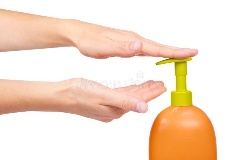 Female hand using liquid soap isolated on white background stock image