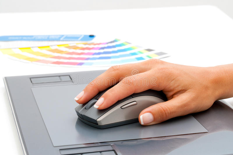 Download Female Hand Using Mouse On Digital Tablet. Royalty Free Stock Images - Image: 25481909