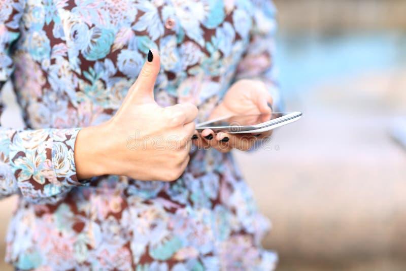 Female hand using a smart phone. Closeup of female hand using a smart phone stock images