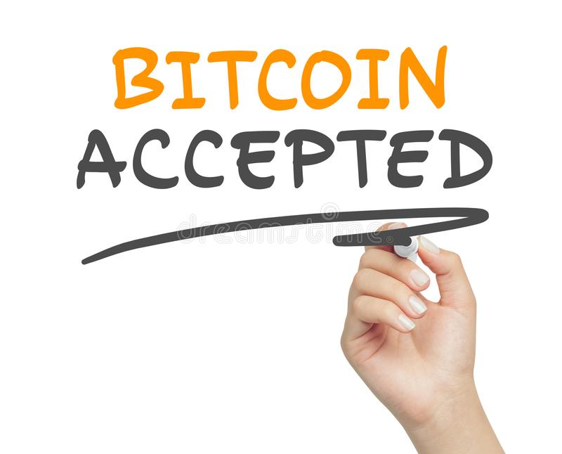 Female hand writing bitcoin accepted message with marker. Woman hand writing bitcoin accepted message and underlining it with marker royalty free stock photography