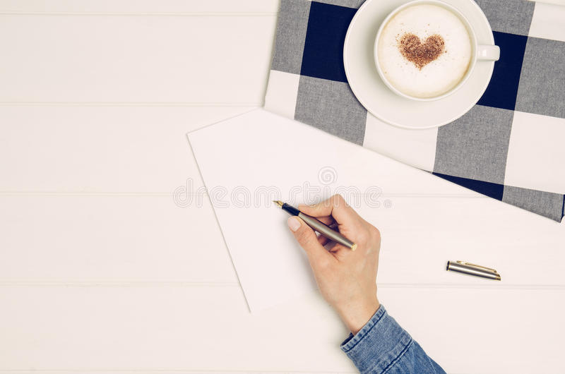 white table top view. Download Female Hand Writing Love Letter On White Table, Top View Stock Photo - Image Table