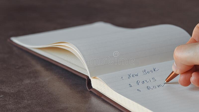Female hand writing in notebook royalty free stock image