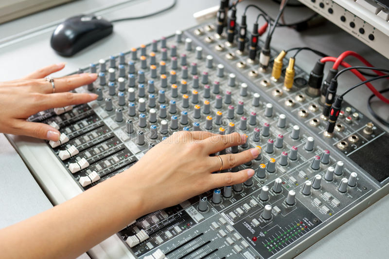Female hands at audio control console stock photos