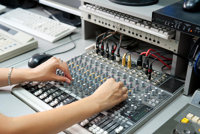 Female hands at audio control console stock images