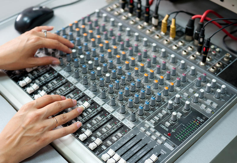 Female hands at audio control console royalty free stock image