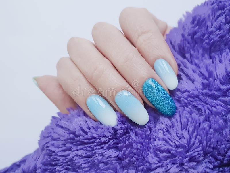 Female hands beautiful gradient winter manicure, fashion sweater stock images