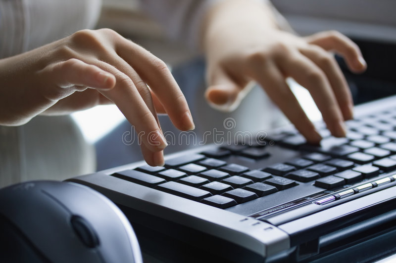 Female Hands On The Black  Keyboard. Stock Image