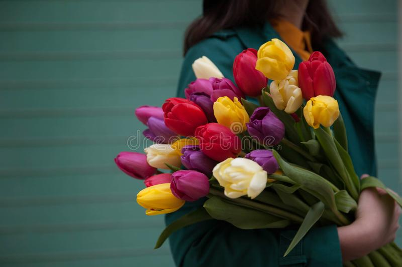 Female hands with a bouquet of flowers stock photo