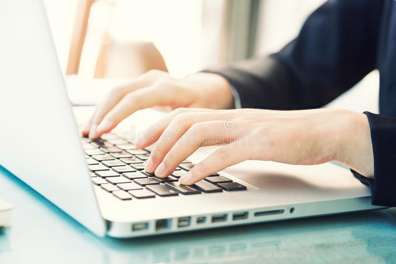 Female hands of business woman typing on computer keyboard stock photography