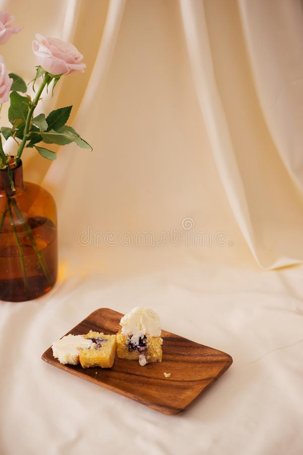 Female hands cut the delicious cupcakes on table.  stock photography