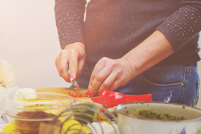 Female hands cut food royalty free stock photo
