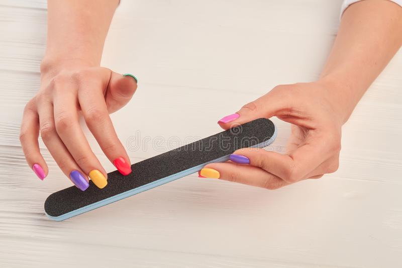 Female Hands Filing Nails With Nail File. Stock Image - Image of ...