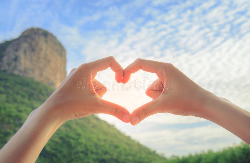 Female hands in the form of heart. Love concept stock photography