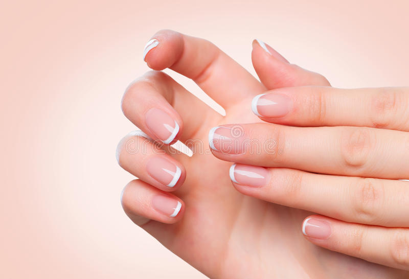 Female hands with french manicure. Spa and skincare royalty free stock photography