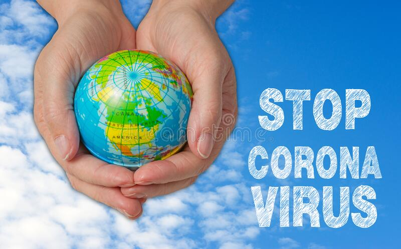 Female hands with globe, stop corona virus royalty free stock images