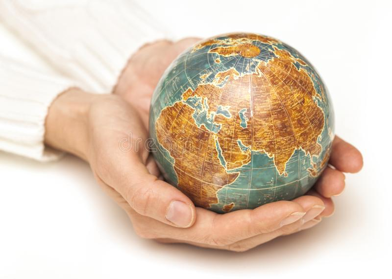Female hands hold the Globe stock images