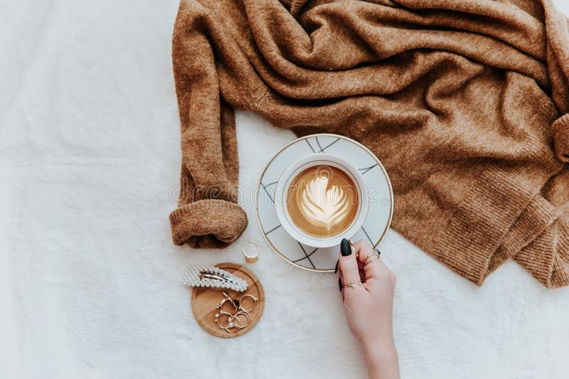 Female hands hold latte coffee cup, stock images