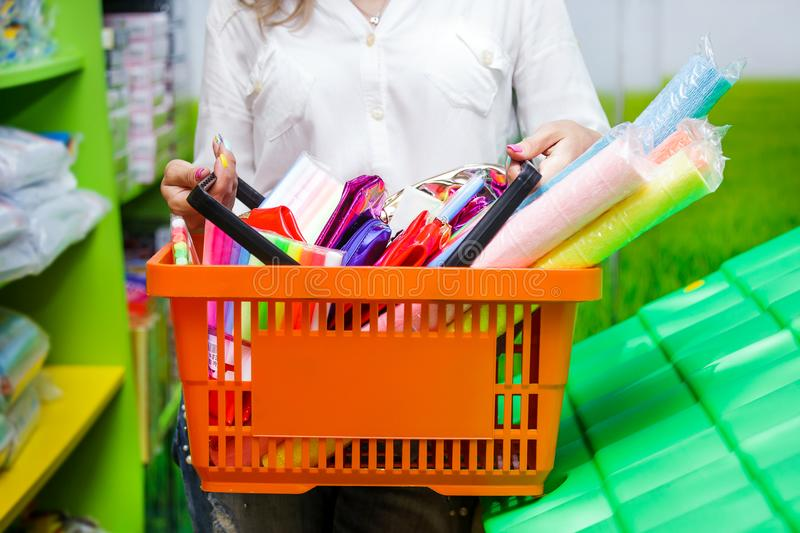 Basket orange white green buy mall young woman troley shopping supermarket stationery purchases hand royalty free stock image