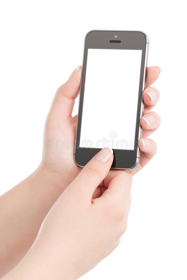 Female hands holding black modern smart phone and pressing button by the thumb royalty free stock photos