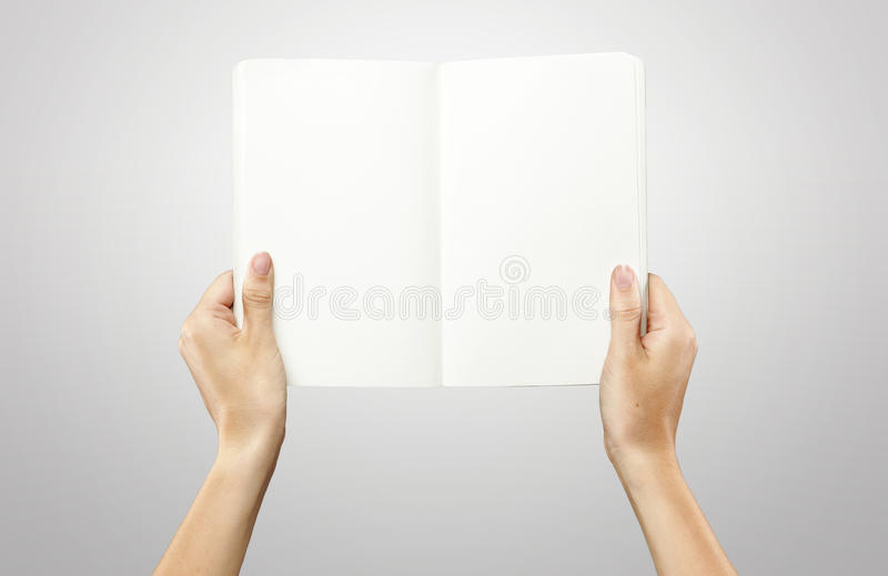 Female hands holding a blank white notebook royalty free stock photography