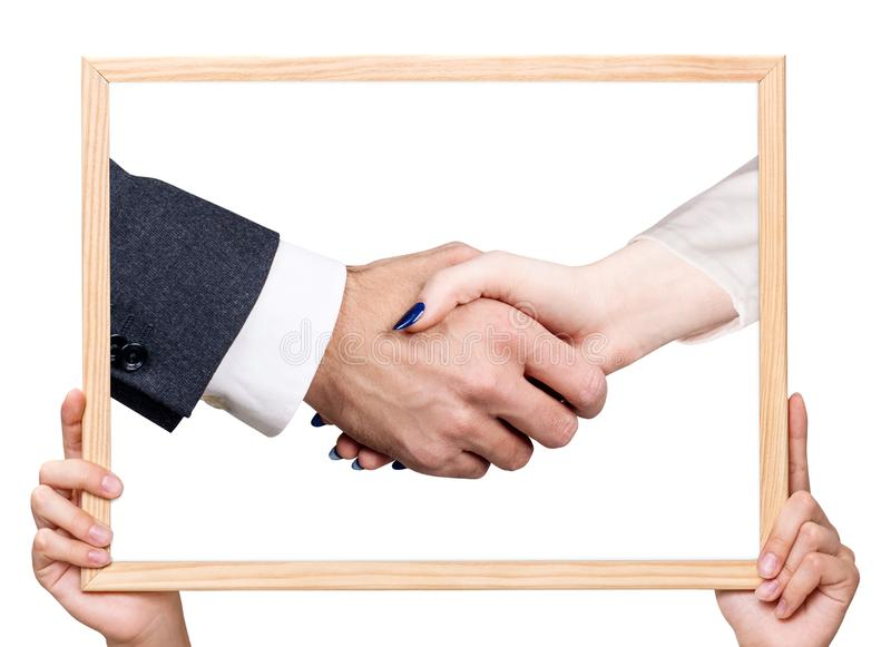 Female hands holding board with hand shake. Isolated on white stock photo