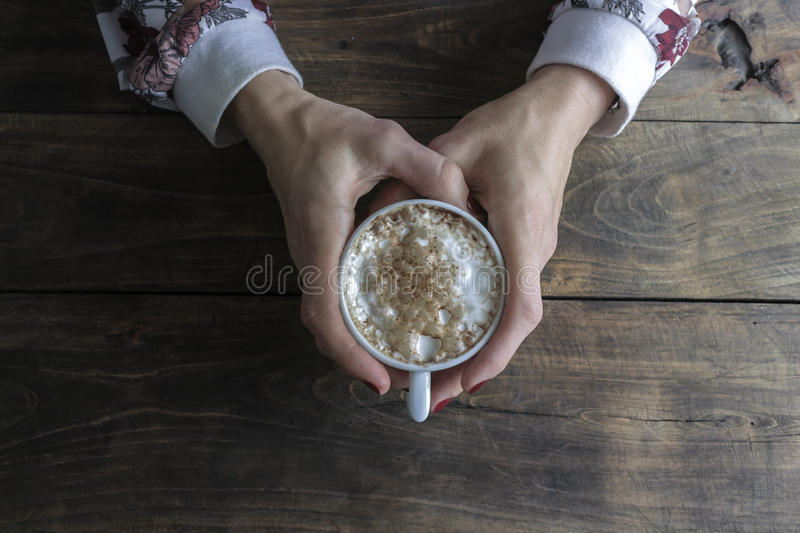 Female Hands Holding Cup Of Coffee. From Above royalty free stock photo