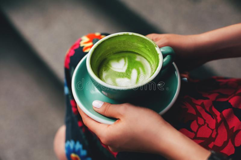 Female hands holding cup of coffee stock photo