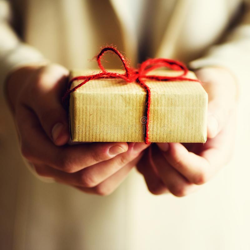 Female hands holding gift box, copy space. Christmas, hew year, birthday, valentines day concept. Female hands holding gift box, copy space. Christmas, hew year stock photography
