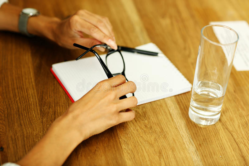 Female hands holding glasses royalty free stock photos