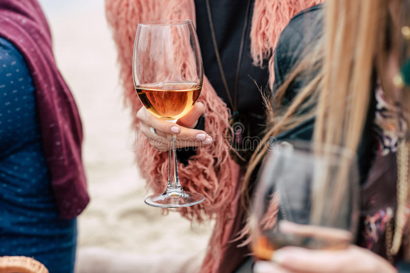 Female hands holding glasses with wine royalty free stock photo