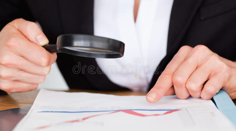 Female hands holding a magnifying glass royalty free stock photo