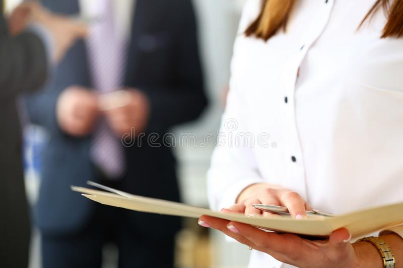 Female hands holding manila folder with important document. Closeup royalty free stock images