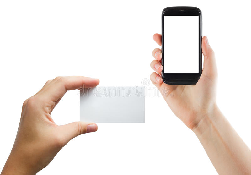 Female hands holding mobile phone with isolated screen and blank business credit card isolated on white background.  stock photo