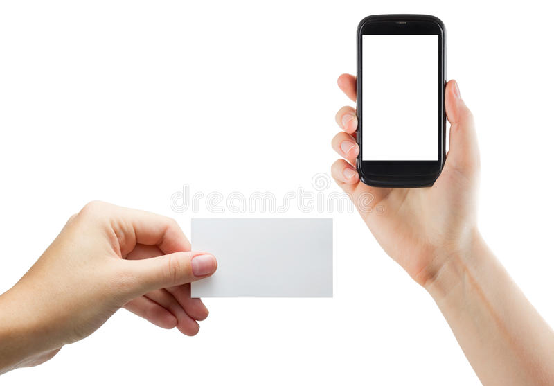 Female hands holding mobile phone with isolated screen and blank business credit card isolated on white background.  stock photography