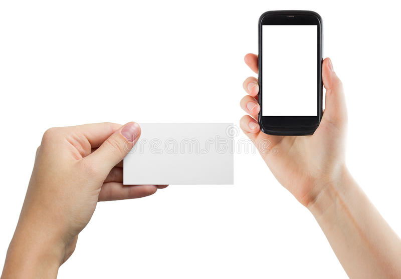 Female hands holding mobile phone with isolated screen and blank business credit card isolated on white background.  stock images