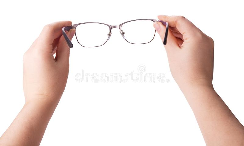 Female hands holding a pair of glasses royalty free stock photography