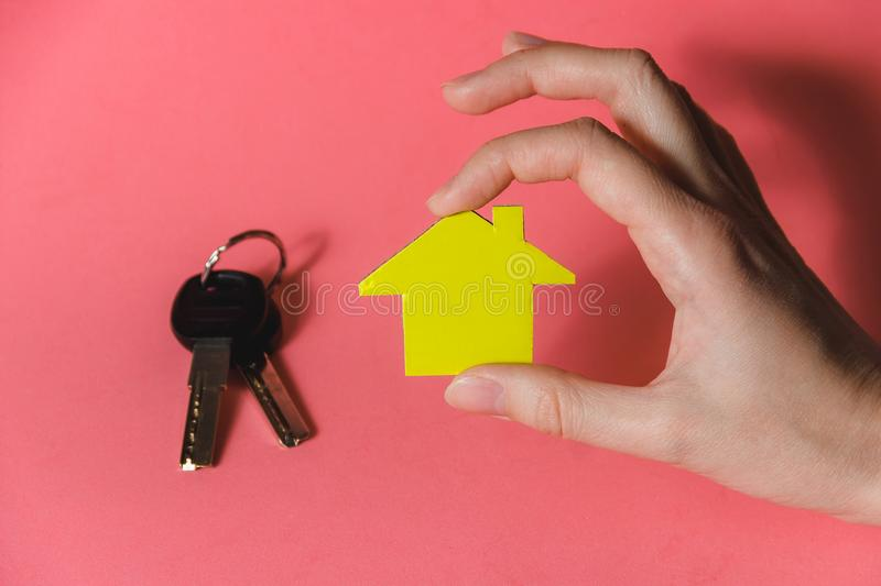 Female Hands Holding Yellow Paper House, Homeless Housing Shelter and Real Estate , Family House Insurance Concept. Female Hands Holding Yellow Paper House royalty free stock photography