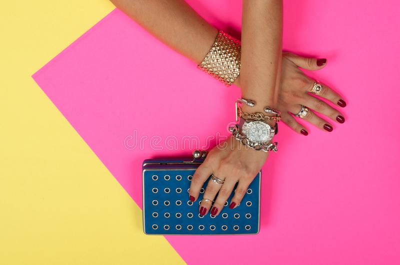 Female hands with jewelry. Fashion accessories, wrist watches, glamor bracelets. And rings royalty free stock images