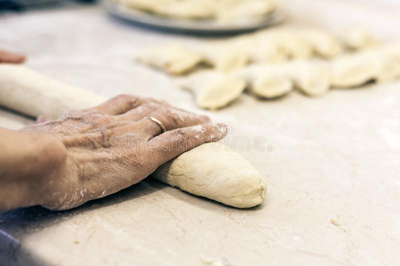 Female hands kneading making dough for dumplings.  stock photos