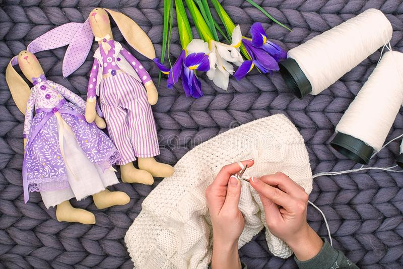 Female hands knit a blanket with knitting needles. Hobby. royalty free stock photos