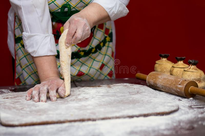 Female hands making dough for pizza. Making bread. Cooking Process Concept royalty free stock photo