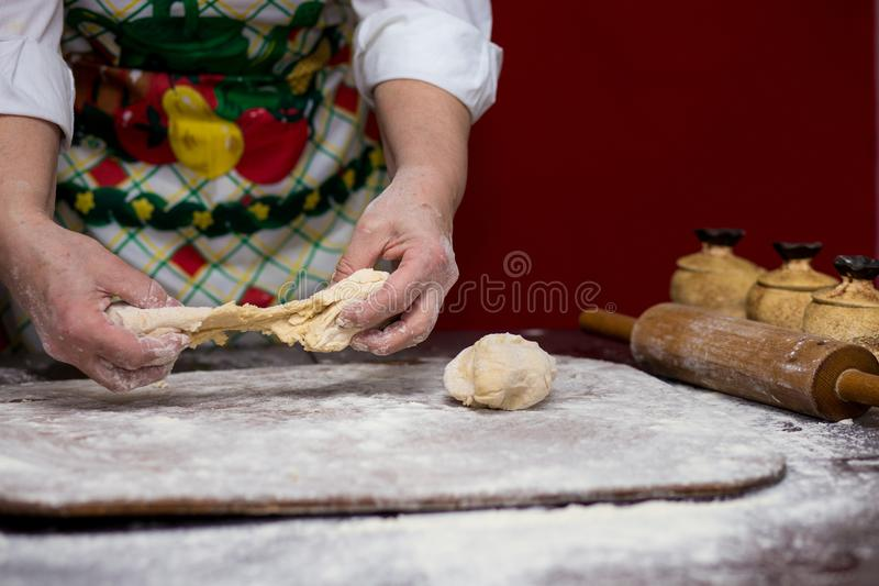 Female hands making dough for pizza. Making bread. Cooking Process Concept royalty free stock image