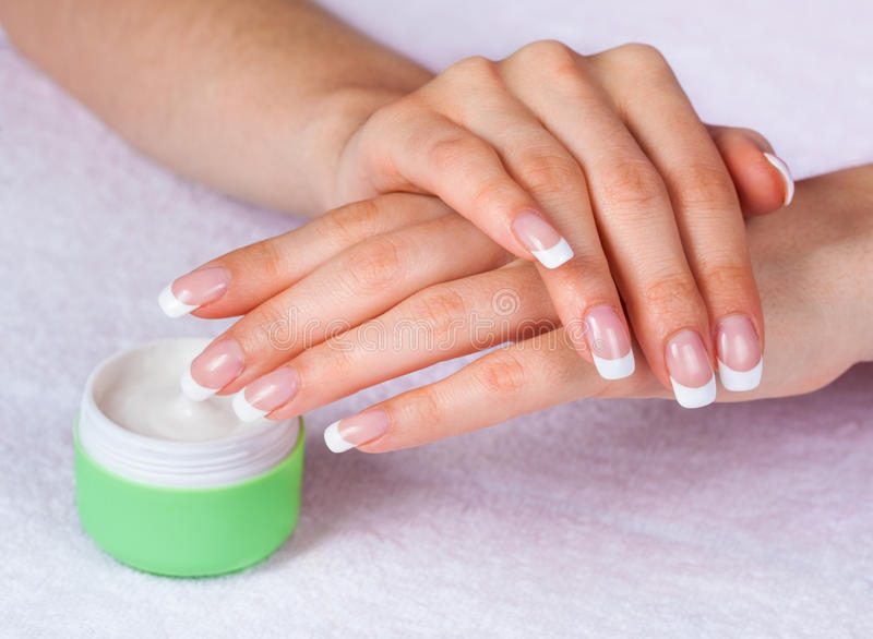 Female hands with near jar of cream royalty free stock images