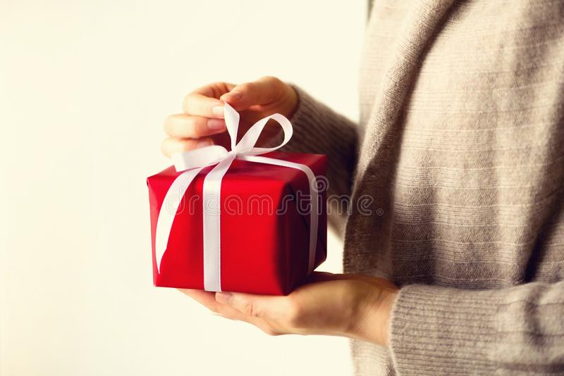 Female hands opening red gift box, copy space. Christmas, new year, birthday party, valentine`s day, mother`s and woman royalty free stock photos
