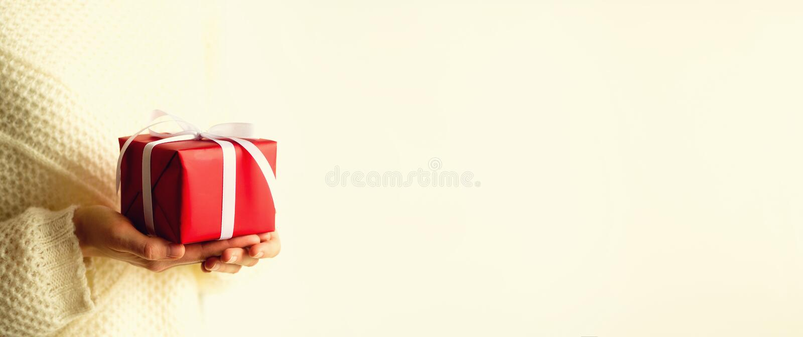 Female hands opening red gift box, copy space. Christmas, new year, birthday party, valentine`s day, mother`s and woman royalty free stock photo