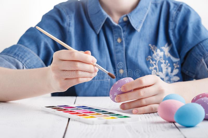 Female hands painting Easter eggs stock photography