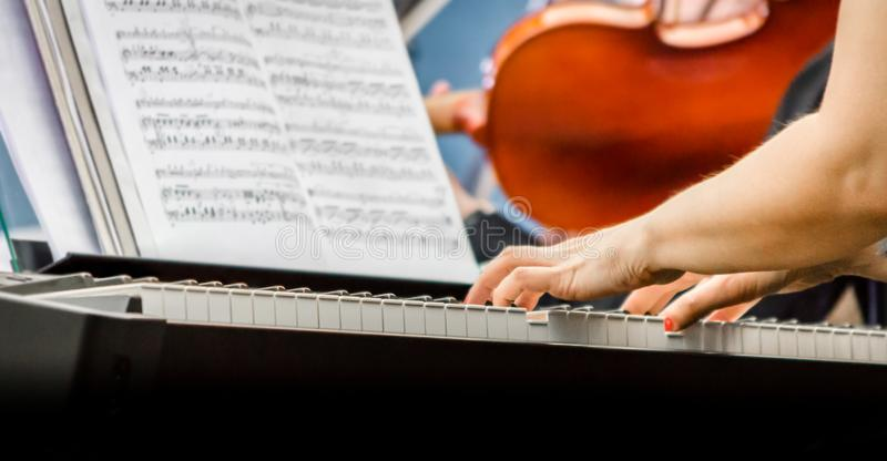 Female hands of a pianist musician and piano keys close up royalty free stock photo