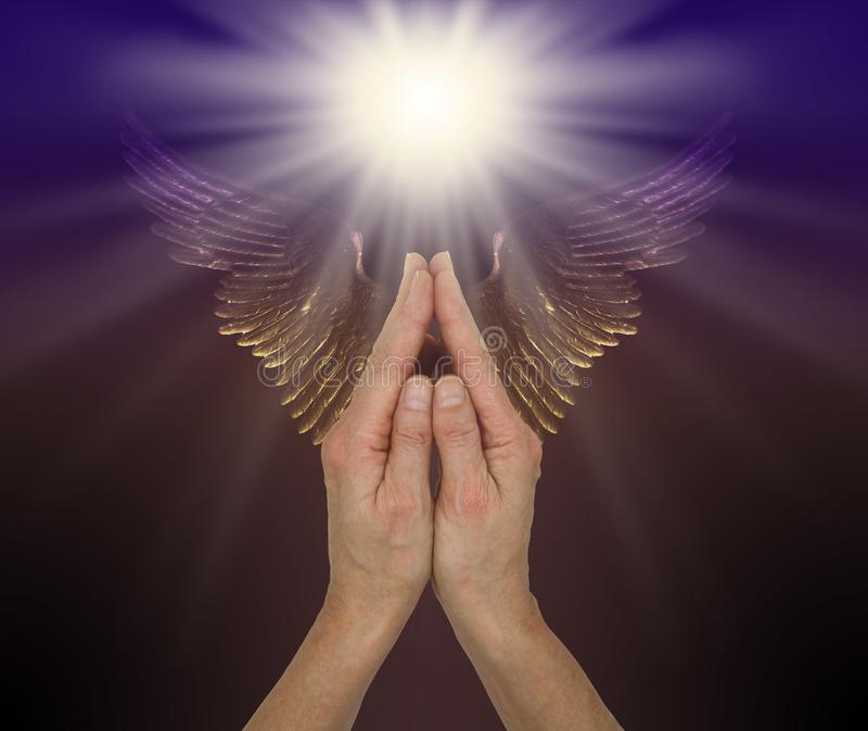 Praying for help from the Angelic Realms stock photos