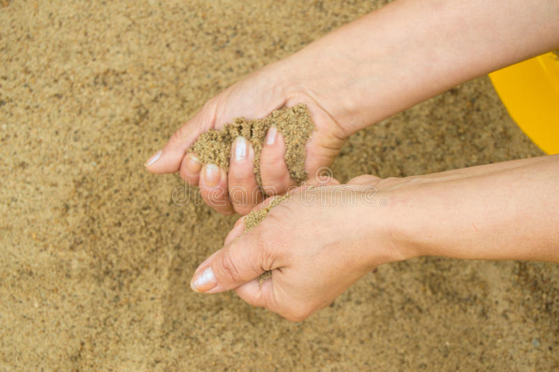 Female hands with sand, the concept of vacation and holidays stock photo